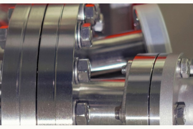 How do you reduce outgassing in vacuum systems?