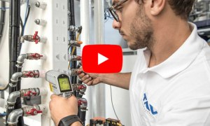 How do you calibrate the vacuum furnace water cooling system?